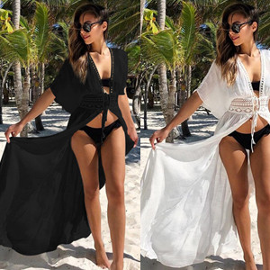 Side by side images of a long haired brunette in a black coverup dress on the left, and the same person in a white coverup dress on the right.